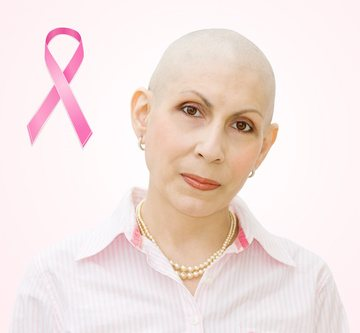 Breast cancer patient with hair loss and cancer research ribbon