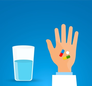 Taking the pill medication.Person holds in hands capsule next to the glass of water