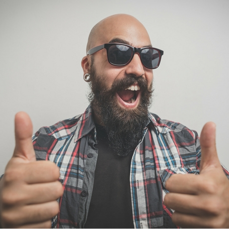 happy guy with shaved head and facial hair