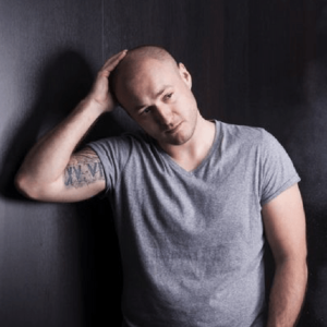 Does stress affect your hairline? Photo of man with receding hair looking distressed