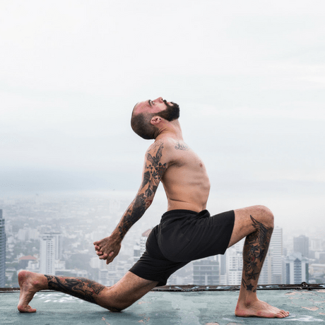 yoga for hair loss- does it work? man with thin hair yoga on top of building