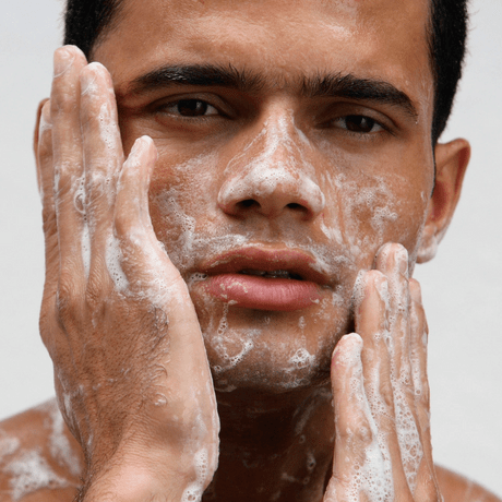 man cleansing his face for fresh skin